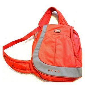 Tumi sling backpack red with grey accents